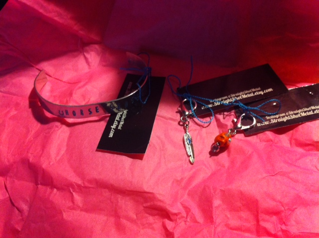 Yay, goodies! Cuff and two bridle charms.