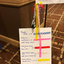 """Trail markers"" -- follow the ribbons to the various rooms/locations for different convention happenings."